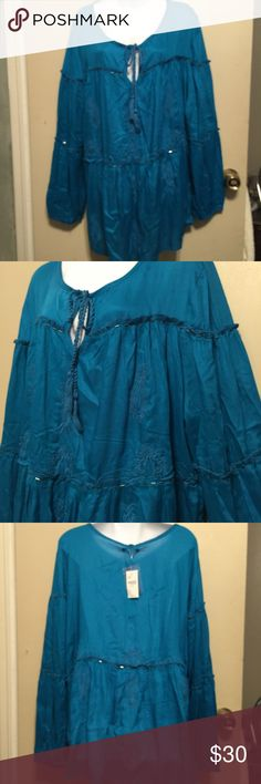 Lane Bryant Turquoise Green 3/4  in sleeves 26/28 100% rayon , Real pretty 3/4 inch sleeves which  ties at neck . Has gathers and silver beads sewn on . Has a embroidery design . The length from shoulder seam to bottom is 291/2 . Sleeves have a button and is 51/2 or 11 circumference Lane Bryant Tops Tunics