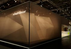 To showcase its myriad paper products that can be used for everything from wallpaper to floorcoverings, Schattdecor AG opts for an angular exhibit cloaked in black transparent fabric. The resulting geometric structure wins a Silver Award.