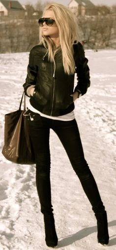 Leather Jacket, comfy white Tshirt, black pants and boots, dont forget the shades . . .cant get any simpler