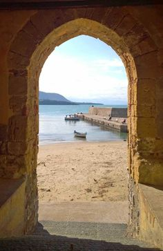 Peeping through an arch in the coastal town of Cefalu, Sicily.