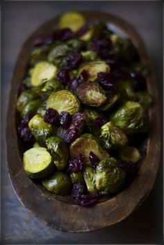 Roasted brussel sprouts with cranberries and balsamic vinegar--a delicious side dish or veggie friendly entree!