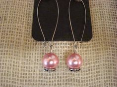 Pink pearl earrings on silver kidney shaped hoops. Free shipping!