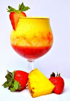 Pineapple Upside Down Cake Daiquiri.  What you need:  1 cup frozen pineapple  2 large strawberries   2 handfuls ice cubes  1 oz. whipped cream vodka  1/2 oz. pineapple rum  2 splashes coconut sparkling water