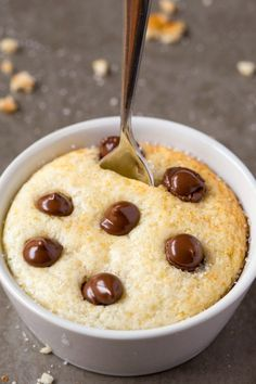 Healthy 1 Minute Low Carb Vanilla Mug Cake which is so fluffy, light and moist in the center! Gluten free, vegan, paleo, sugar free! - thebigmansworld.com