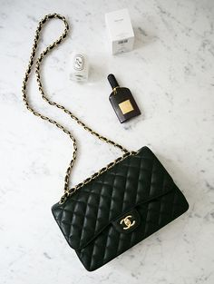 'chanel bag + diptyque scented candle'