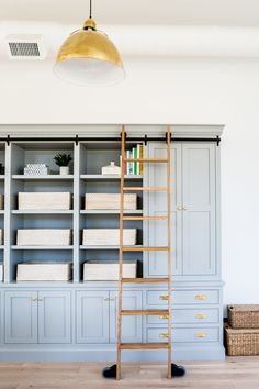 Walls are Chantilly Lace by Benjamin Moore | Built-in is Platinum Gray by Benjamin Moore (It looks bluer in the photos than in person) - Studio McGee
