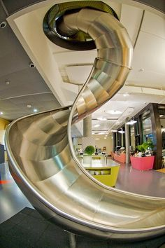 Google Zurich office has a slide and serious style!