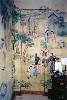 A jib door in a guest bedroom, with walls covered in Chinese paper, circa 1750, by maximalist extraordinaire Howard Slatkin.