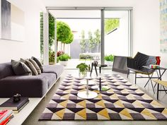 An art deco rug for a masculine living space with an indoor-outdoor concept