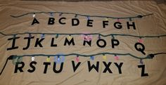 Super easy Stranger Things Alphabet  wall hang.  Old sheet Target $3 alphabet letters Acrilic paint  *Make sure you put something like cardboard underneath while painting! BySusanBurnham