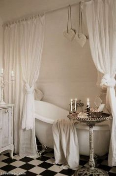 Relaxing Bathroom With Clawfoot Tub And Curtains