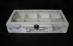 White, shabby, wooden tea box with glass lid and eight compartments on Etsy, $45.00