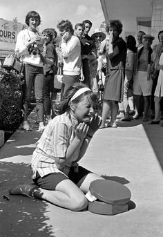 A young fan cries uncontrollably as her heroes, The Beatles, leave America for the UK, 1964