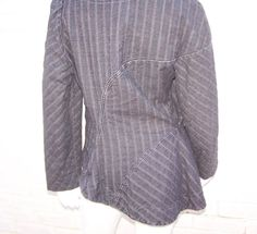 1990's Vivienne Westwood Anglomania Charcoal Denim Asymmetrical Jacket | From a collection of rare vintage jackets at https://www.1stdibs.com/fashion/clothing/jackets/
