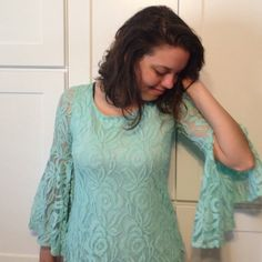 Teal lacy blouse Teal shirt with lacy overlay. Sleeves are lace only and flare out past the bicep. Coveted Clothing Tops Blouses
