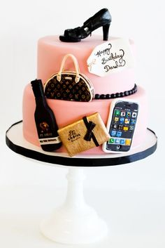 a shoe crowns this cake decked out with an iPhone, purse, and other accessories