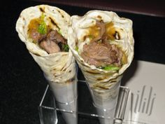 "Shawarma is the most popular food in Dubai. It is made with lamb or chicken which is mixed and cooked with pickle, tomatoes and garlic sauce. These ingredients are then wrapped in Arabic bread called ""Roti"" and served. Taste of shawarma is somewhat like Kebabs but it can vary from one restaurant to another."