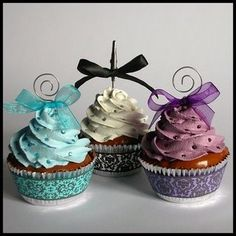 If you want cupckaes, its fancier to have decorated baking cups or cups that don't go into the oven, and the bows on top are cute, but maybe something else is preferred...