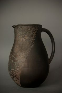 reduction wood-fired earthenware jug by Laima Ceramics