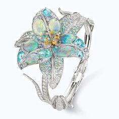 """Opaline """"Etoiles boréales"""" bracelet in black opals, Paraiba tourmalines, yellow and violet sapphires. Chaumet"""