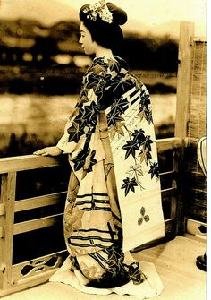 Autumn Leaf Obi--an exquisite photo of young geisha looking out at the river. Probably from the 1930s