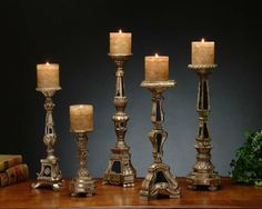 This set of 5 John Richard Candlesticks make a great gift that adds the perfect accent of ambiance to a well decorated room. The set of 5 come at different heights and all uniquely carved with mirrored accents and an antiqued finish. Ideal for a chest in an entry or hallway, or for a large cocktail table, the multiple heights give a sense of variety to any setting.  -  High End Christmas Gifts, GIft Ideas in Orange County | Marc Pridmore Designs Fine Furniture Store