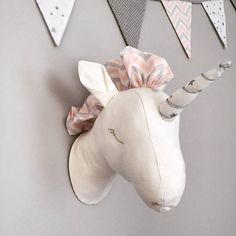 Animal themes are always fun in a kids room. These very cute Unicorn head is ready to ship item. Handmade here in Latvia with care and dedication to detail in pets and smoke free environment.  Unicorn head is made of cotton and sateen and hypo allergenic hollow fibre insert. Eyes