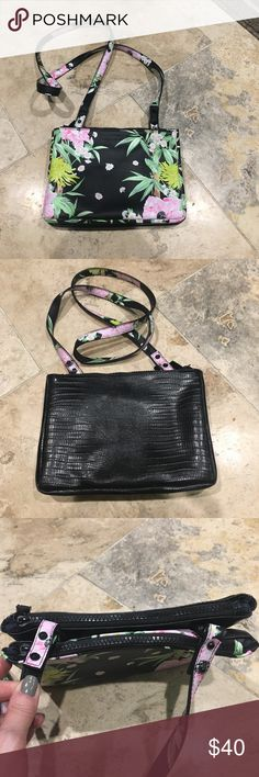 """French Connection floral bamboo print crossbody This is a fun floral bamboo print bag from French Connection. The front is a floral print and back a black faux croc embossed. It's about 9"""" tall you 6"""" wide but it has 2 zippered pouches on each side, it's as if the floral side is one purse and black side another purse put together. Lots of card compartments to stay organized. It was a gift for daughter and there are no tags attached but it looks to be brand new even inside no stains looks…"""