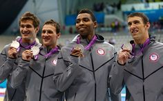 Adrian Nathan, Ryan Lochte, Cullen Jones, and Michael Phelps. Silver medals 4x100 relay.