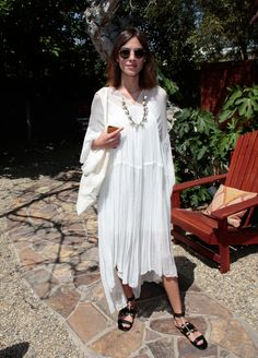 Alexa Chung's oversize bohemian design is lightweight enough to throw on for a day at the beach, but it can easily be dressed up with standout accessories.