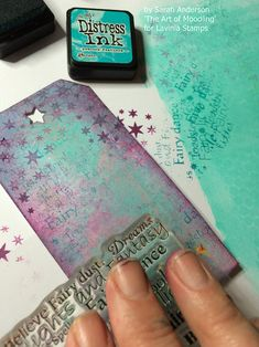 Stamp fragments of fairy words over the tag using 'peacock feathers' distress…
