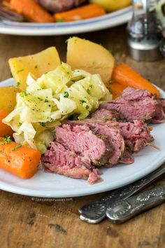Slow Cooker Corned Beef and Cabbage packs all of the deliciousness of a good Irish meal into an easy meal that is perfect for St. Patrick's Day!