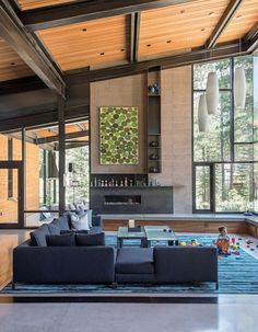 Photo 45 of 50 in 50 Modern Homes With Floor-to-Ceiling Windows from A Forest Sanctuary Designed to Support Autistic Triplets, Their Parents, and a Host of Caregivers - Dwell Architecture Design, Forest View, Mountain Modern, Floor To Ceiling Windows, Raked Ceiling, Big Windows, Living Room Modern, Living Rooms, Living Area