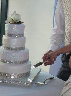 Wedding Cake - bling  sparkle with edible glitter-would do with a colored ribbon instead of the rhinestones.
