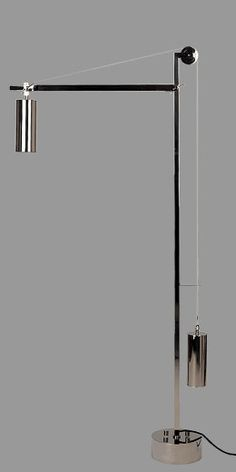 Bauhaus Floor Lamp ~ 1923    BH 23 Bauhaus floor lamp by Tecnolumen - metal nickel plated.  Impacting the world of design.  A show piece.