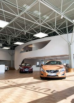 Google Image Result for http://interiorzine.com/wp-content/uploads/2011/02/volvo-motor-showroom3.jpg