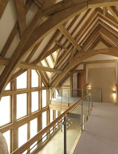Vaulted landing with arch brace oak trusses and gable overlooking garden