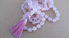 Rose quartz mala  Hand knotted 8mm rose quartz 108 beads mala pink tassel necklace by Sphalie on Etsy 80.28$