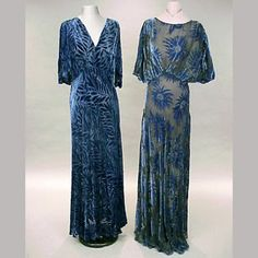 Two Blue Cut Velvet Evening Gowns  American, 1930s   Each cut velvet chiffon, the first all blue, with velvet leaf pattern, V-neck, cape sleeves, back cut out with two Vs, the second blue floral pattern on black ground, with puffed half sleeves, black slip    Read more: 1930s : Fashion of the Stylish Thirties - Page 13 - the Fashion Spot http://forums.thefashionspot.com/f116/1930s-fashion-stylish-thirties-62282-13.html#ixzz1lMXXY1Lv