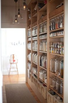 Pantry Pride ... not enough space for a walk-in pantry, line a kitchen wall or hallway off the kitchen with shelves … and stock up on pretty glass airtight containers.