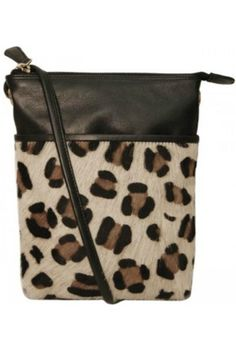 This wonderful ladies bag is fully lined and made from a combination of top grain leather and leopard print pony hair leather. Cross-body with adjustable shoulder strap Front slide pocket. Back and interior zip pockets.    Dimensions: 6 x 7.5 x 1.25 in   Leopard Leather Crossbody by BAS. Bags - Cross Body New York