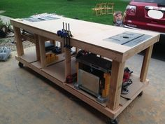 After 11 hours of work (including the trip to Home Depot to buy the lumber), this is what I've upgraded to. No more using the kids' toys in the garage as temporary sawhorses! I can use the table saw, planer, and router in place, and I'll be mounting a drill press on top too. The jointer will be stored underneath, since I don't use it that often and it's not that heavy.