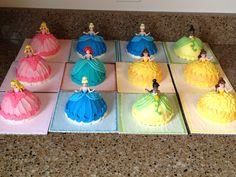 - Mini princess doll cakes for my nieces birthday. Chocolate cake with vanilla buttercream. These were actually jumbo cupcakes turned upside down and carved. I inserted little Disney Princess figures in the middle. They loved them!
