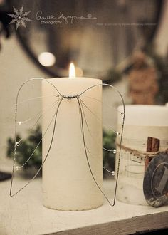 Wire and bead angel wings to add to pillar candles. Link is dead - but simple to re-create! Christmas Angels, All Things Christmas, Christmas Holidays, Christmas Crafts, Christmas Decorations, Christmas Ornaments, Christmas Candle, Crafts To Sell, Diy And Crafts