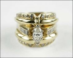 Lot: A DIAMOND AND 14 KARAT YELLOW GOLD RING., Lot Number: 1507391, Starting Bid: $500, Auctioneer: Susanin's Auctions, Auction: Sale 150: April Premiere Auction, Date: April 18th, 2015 CDT