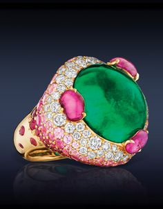 Emerald Cocktail Ring, Cabochon Colombian Emerald (Center Stone) Surmounted by Rubies , Highlighted with Pink Sapphires, Round Rubies and White Diamonds, Mounted in 18K Rose Gold.