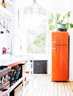 bright orange smeg inside elsa billgren's home / sfgirlbybay