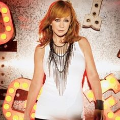 Reba McEntire.. The hottest red head on the planet.