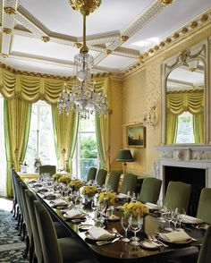 The Wimborne Room at the Ritz London has an elegant feel for intimate, private dining. Diners look over Green Park as they indulge around the grand mahogany dining table.