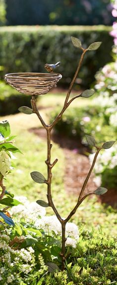 A solitary bird and nest rest on a gracefully arching branch to make our Bird Nest Garden Stake a beautiful sculptural design.